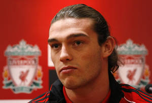 Photo -   FILE- Liverpool's new signing Andy Carroll talks to media during a press conference at Anfield, Liverpool, England, in this file photo dated Thursday Feb. 3, 2011. Liverpool has sent Andy Carroll on a season-long loan to English Premier League rival West Ham, it is announced Thursday Aug. 30, 2012, just 19-months after signing the England striker for a club-record fee of 35 million pounds (then US $56 million), after Carroll failed to establish himself as a regular player on the Liverpool squad. (AP Photo/Tim Hales, file)