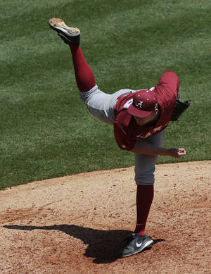 Photo - Alabama's Spencer Turnbull throws in the seventh inning of their Southeastern Conference tournament college baseball game against Mississippi at the Hoover Met in Hoover, Ala., Thursday, May 23, 2013. (AP Photo/Dave Martin)