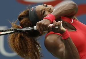 Photo - Serena Williams returns a shot to Sloane Stephens during the fourth round of the 2013 U.S. Open tennis tournament, Sunday, Sept. 1, 2013, in New York. (AP Photo/Darron Cummings)