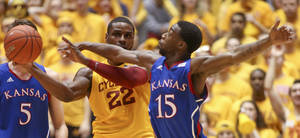Photo - Kansas guard Elijah Johnson tries to knock the ball away from Iowa State forward Anthony Booker (22) during the first half of an NCAA college basketball game Monday, Feb. 25, 2013, at Hilton Coliseum in Ames, Iowa. Johnson scored 39 points and Kansas won the game 108-96 in overtime. (AP Photo/Justin Hayworth)