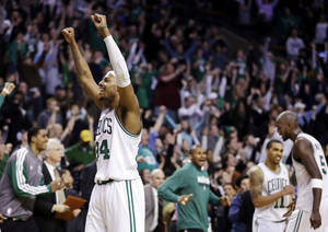 photo - Boston Celtics forward Paul Pierce (34) reacts to the crowd after they defeated the Denver Nuggets 118-114 in triple overtime in an NBA basketball game in Boston, Sunday, Feb. 10, 2013. (AP Photo/Elise Amendola)