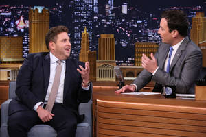 "Photo - This June 3, 2014 photo released by NBC shows actor Jonah Hill, left, with host Jimmy Fallon during a taping of ""The Tonight Show with Jimmy Fallon,"" in New York. Hill apologized for using a gay slur with a paparazzo in an encounter caught on video. Hill also acknowledged on ""The Howard Stern Show"" on Tuesday, that he said ""a disgusting word.""  (AP Photo/NBC, Douglas Gorenstein)"
