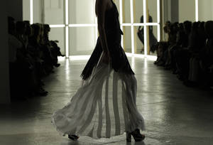 Photo -   A model walks the runway during the presentation of the Rodarte Spring 2013 collection at Fashion Week in New York, Tuesday, Sept. 11, 2012. (AP Photo/Kathy Willens)