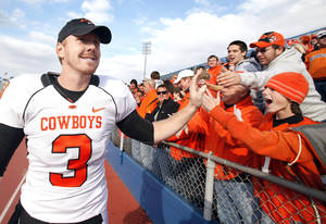 Photo - Oklahoma State's Brandon Weeden (3) celebrates the Cowboys' win over Kansas with fans, Saturday, Nov. 20, 2010 at Memorial Stadium in Lawrence, Kan. Photo by Sarah Phipps, The Oklahoman