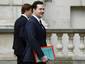 Photo - Britain's Chancellor of the Exchequer, George Osborne, right, walks with Chief Secretary to the Treasury, Danny Alexander, to deliver the half-yearly budget statement to parliament in London, Wednesday Dec. 5, 2012. Britain's Treasury chief, George Osborne, unveiled plans to kick-start the U.K.'s moribund economy when he presented his updated budget policies to lawmakers. (AP Photo/Andrew Winning, Pool)
