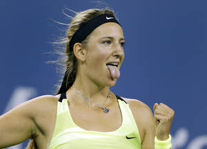 Photo -   Victoria Azarenka, of Belarus, celebrates her 6-0, 6-1, win over Zheng Jie, of China, in the third round of play at the U.S. Open tennis tournament, Friday, Aug. 31, 2012 in New York. (AP Photo/Charles Krupa)