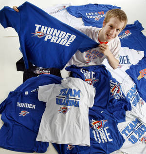 Photo - OKC Thunder fan Jackson Kinnear poses for a photo with his twenty Oklahoma City Thunder playoff shirts, one from every playoff game through the 2012 Western Conference Finals, in Oklahoma City, Friday, June 8, 2012. Photo by Nate Billings, The Oklahoman