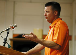 Photo - Head coach Mike Gundy speaks during media day for the Oklahoma State University football team inside OSU's Gallagher-Iba Arena, Saturday, Aug. 3, 2013. Photo by Nate Billings, The Oklahoman