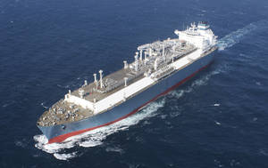 Photo - This Jan. 26, 2014 photo provided by Hoegh LNG on Tuesday, April 22, 2014 shows Hoegh's gas vessel 'Independence'  during her sea trial. Later this year, the giant ship will slide up to Lithuania's Baltic port of Klaipeda. The 390-meter (1,300 foot) vessel is bigger than the largest aircraft carrier, but it's not a warship. The floating natural gas terminal will play a key role in the Baltic region's struggle to lessen its energy dependence on Russia. (AP Photo/Hoegh LNG)