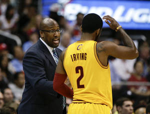Photo - Cleveland Cavaliers's Mike Brown, left, talks to Kyrie Irving during the first half of an NBA basketball game against the Los Angeles Clippers on Sunday, March 16, 2014, in Los Angeles. (AP Photo/Jae C. Hong)