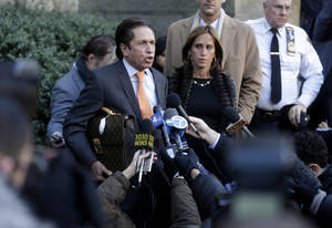 photo - Mark Heller, an attorney for actress Lindsay Lohan, leaves the courthouse, Monday, Jan. 7, 2013, in New York. Heller signed paperwork at the courthouse in connection with Lohan's alleged fight at a Manhattan nightclub on Nov. 29, 2012. (AP Photo/Seth Wenig)