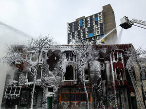 Photo - Firefighters work the scene where a fire engulfed several apartment units in the Cedar Riverside neighborhood, in Minneapolis, Wednesday, Jan. 1, 2014. Authorities say at least 13 people have been hurt. (AP Photo/Star Tribune, McKenna Ewen)