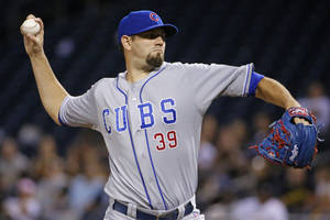 Photo - Chicago Cubs starting pitcher Jason Hammel delivers during the first inning of a baseball game against the Pittsburgh Pirates in Pittsburgh Wednesday, June 11, 2014. (AP Photo/Gene J. Puskar)