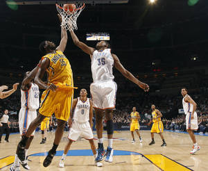 Photo - Oklahoma City's Kevin Durant (35) fights Indiana's Roy Hibbert (45) for a rebound during the basketball game between the Oklahoma City Thunder and the Indiana Pacers, Saturday, Jan. 9, 2010 at the Ford Center in Oklahoma CIty. PHOTO BY SARAH PHIPPS, THE OKLAHOMAN