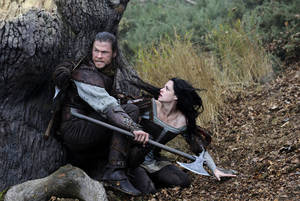 "Chris Hemsworth stars as the Huntsman and Kristen Stewart as Snow White in ""Snow White and the Huntsman."" UNIVERSAL PICTURES PHOTO"