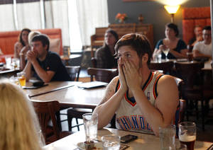 Photo - Wes Behrens reacts to a play as watch the Thunder play Miami in the NBA Finals on television at Saint's Pub in Oklahoma City, Sunday, June 17, 2012. Photo by Sarah Phipps, The Oklahoman <strong>SARAH PHIPPS - SARAH PHIPPS</strong>