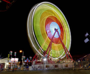 Photo - The Ferris wheel spins Wednesday at the Oklahoma State Fair in Oklahoma City. Photo by Bryan Terry, The Oklahoman  <strong>BRYAN TERRY</strong>