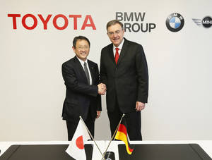 "photo - In this photo released by Toyota Motor Corp., Toyota President Akio Toyoda, left, shakes hands with BMW AG chief executive Norbert Reithofer during a signing ceremony to jointly develop next-generation batteries for green vehicles in Nagoya, central Japan, Thursday, Jan. 24, 2013.  Toyota and BMW are working together on next-generation batteries for green vehicles called ""lithium-air"" as their collaboration, first announced in late 2011, moves ahead in fuel cells, sports vehicles and other fields. (AP Photo/Toyota Motor Corp.) EDITORIAL USE ONLY"