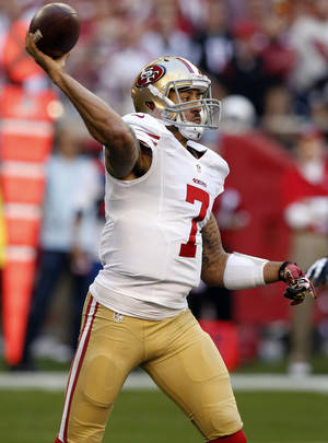 Photo - San Francisco 49ers quarterback Colin Kaepernick throws against the Arizona Cardinals during the first half of an NFL football game, Sunday, Dec. 29, 2013, in Glendale, Ariz.  (AP Photo/Ross D. Franklin)