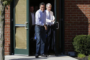 Photo -   Republican presidential candidate and former Massachusetts Gov. Mitt Romney and Sen. Rob Portman, R-Ohio, emerge from debate preparation at a hotel in Columbus, Ohio, Saturday, Oct. 13, 2012. (AP Photo/Charles Dharapak)
