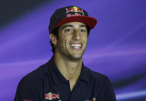 Photo - Toro Rosso driver Daniel Ricciardo of Australia smiles during a  news conference at the Monza racetrack, in Monza, Italy , Thursday, Sept. 5 , 2013. The Formula one race will be held on Sunday. (AP Photo/Luca Bruno)
