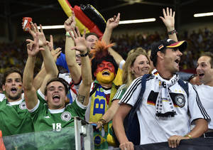 Photo - German supporters celebrate after the World Cup semifinal soccer match between Brazil and Germany at the Mineirao Stadium in Belo Horizonte, Brazil, Tuesday, July 8, 2014. Germany won the match 7-1. (AP Photo/Martin Meissner)
