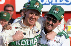 Photo - FILE - In this Oct. 10, 1988, file photo ,NASCAR driver Rusty Wallace of St. Louis, Mo., left, hugs his crew chief Barry Dodson in victory lane after winning the Oakwood Homes 500 auto race at the Charlotte Motor Speedway in Concord, N.C. Wallace, a winner of 55 races and the 1989 championship, will be inducted Friday night, Feb. 8, 2013, into the NASCAR Hall of Fame, along with Buck Baker and Herb Thomas; car owner Cotton Owens and crew chief, mechanic and engine builder Leonard Wood. (AP Photo/Robert Willett, File)