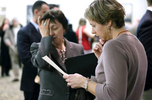 photo - In this Monday, Feb. 25, 2013. Ann Oganesian, left, of Newton, Mass., pauses as she speaks with a State Dept. employee about job opportunities with the federal government during  a job fair in Boston. The Labor Department is scheduled to release the jobs report at 8:30 a.m. EST Friday March 8, 2013. (AP Photo/Michael Dwyer)