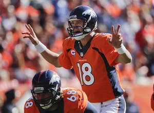 Photo - Denver Broncos quarterback Peyton Manning (18) calls an audible at the line of scrimmage against the Jacksonville Jaguars in the first quarter of an NFL football game, Sunday, Oct. 13, 2013, in Denver. (AP Photo/Jack Dempsey)