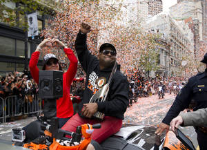 Photo -   San Francisco Giants third baseman Pablo Sandoval waves to fans on Market Street during the parade in celebration of the baseball team's victory in the World Series, Wednesday, Oct. 31, 2012, in San Francisco. (AP Photo/The Sacramento Bee, Paul Kitagaki Jr.) MAGS OUT; TV OUT (KCRA3, KXTV10, KOVR13, KUVS19, KMAZ31, KTXL40) MANDATORY CREDIT
