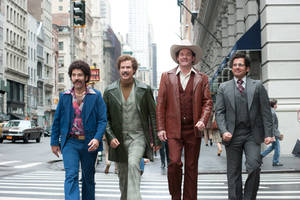 "Photo - This image released by Paramount Pictures shows, from left, Paul Rudd is Brian Fantana, Will Ferrell is Ron Burgundy, David Koechner is Champ Kind and Steve Carell is Brick Tamland in a scene from ""Anchorman 2: The Legend Continues."" (AP Photo/Paramount Pictures, Gemma LaMana)"