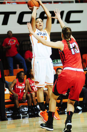 Photo - Oklahoma State guard Brittney Martin shoots over a defender during the Oklahoma State womens' basketball season opener versus Lamar on Nov. 8, 2013 at Gallagher Iba Arena in Stillwater, Okla. Photo by KT King/For the Oklahoman