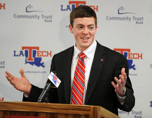 Photo - Tyler Summitt smiles during a press conference where it was formally announced that he will take over as the new Louisiana Tech women's basketball coach, Wednesday, April 2, 2014 in Ruston, La. The 23-year-old Summitt is the son of Hall-of-Fame Tennessee Lady Vols coach Pat Summitt. (AP Photo/The Shreveport Times, Douglas Collier) MAGS OUT; MANDATORY CREDIT SHREVEPORTTIMES.COM;  NO SALES