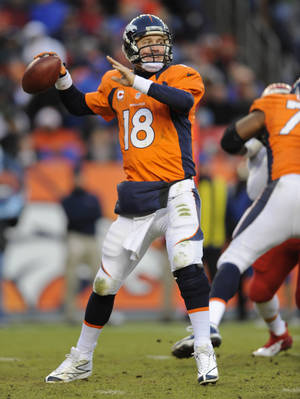 Photo - Denver Broncos quarterback Peyton Manning steps back to pass against the Kansas City Chiefs in the fourth quarter of an NFL football game, Sunday, Dec. 30, 2012, in Denver. (AP Photo/Jack Dempsey)