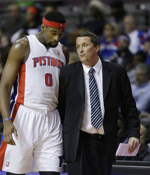 Photo - Detroit Pistons center Andre Drummond (0) talks with interim head coach John Loyer during the first half of an NBA basketball game against the San Antonio Spurs in Auburn Hills, Mich., Monday, Feb. 10, 2014. (AP Photo/Carlos Osorio)