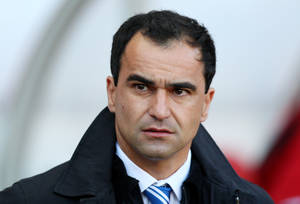Photo -   Wigan Athletic's manager Roberto Martinez looks on ahead of their English Premier League soccer match against Sunderland at the Stadium of Light, Sunderland, England, Saturday, Sept. 29, 2012. (AP Photo/Scott Heppell)