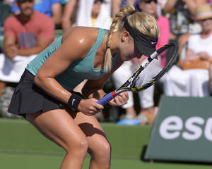 Photo - Eugenie Bouchard, of Canada, celebrates her 6-3, 6-3 win over Sara Errani, of Italy, in a match at the BNP Paribas Open tennis tournament on Sunday, March 9, 2014, in Indian Wells, Calif. (AP Photo/Mark J. Terrill)