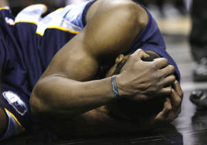 Photo - Memphis Grizzlies' Tony Allen holds his head after he was fouled by San Antonio Spurs' Manu Ginobili during the second half in Game 2 of a Western Conference Finals NBA basketball playoff series, Tuesday, May 21, 2013, in San Antonio. (AP Photo/Eric Gay)