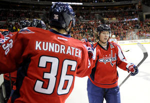 photo - Washington Capitals center Nicklas Backstrom (19), of Sweden, celebrates his goal with teammate Tomas Kundratek (36), of the Czech Republic, during the second period of an NHL hockey game against the Philadelphia Flyers, Friday, Feb. 1, 2013, in Washington. (AP Photo/Nick Wass)