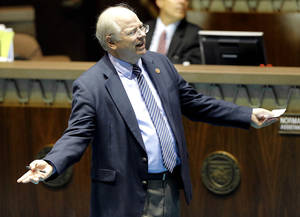 Photo - Arizona House Speaker Rep. Andy Tobin, R-Paulden speaks on the floor during a recess prior to a special session for Medicaid funding on Thursday, June 13, 2013, in Phoenix. (AP Photo/Matt York)