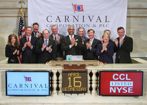 Photo - In this photo provided by the New York Stock Exchange Euronext, Carnival Corporation President and Chief Executive Officer, Arnold W. Donald, center, and guests, gather on the podium for the closing bell at the Exchange on Wednesday, April 16, 2014, in New York. Carnival Corporation is headquartered in Doral, Fla; a suburb of Miami. (AP Photo/New York Stock Exchange Euronext, Dario Cantatore)