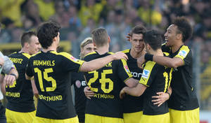 Photo - From left: Dortmund's  Kevin Großkreutz, Mats Hummels, Marcel Schmelzer, Lukasz Piszczek, Sebastian Kehl, Nuri Sahin und Pierre-Emerick Aubameyang celebrate the opening goal by Sebastian Kehl during the German first division Bundesliga soccer match between SC Freiburg and Borussia Dortmund in Freiburg, southern Germany, Sunday March 9, 2014. (AP Photo/dpa,Patrick Seeger)