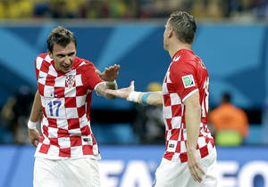 Photo - Croatia's Mario Mandzukic, left, celebrates with Croatia's Ivica Olic after scoring his side's third goal during the group A World Cup soccer match between Cameroon and Croatia at the Arena da Amazonia in Manaus, Brazil, Wednesday, June 18, 2014.   (AP Photo/Themba Hadebe)