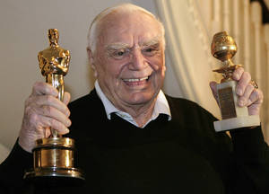 FILE - In this Jan. 13, 2008, file photo, actor Ernest Borgnine displays for a television crew, his Golden Globe, right, and Oscar awards he received in 1956 for the movie &#039;Marty&#039; in Beverly Hills, Calif.  A spokesman said Sunday, July 8, 2012, that Borgnine has died at the age of 95. (AP Photo/Ric Francis, File) ORG XMIT: NY804