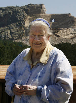 Photo - FILE - In this June 13, 2006 file photo, Ruth Ziolkowski, widow of sculptor Korczak Ziolkowski who began carving the likeness of Sioux warrior Crazy Horse into a granite mountain in 1948, stands in front of the ongoing project at Crazy Horse Memorial in the Black Hills near Custer, S.D. Ruth, who took over the dream of her husband, upon his death in 1982 and turned it into a multimillion-dollar operation that draws more than a million visitors a year, died Wednesday May 21, 2014 at age 87 according to a spokesman. (AP Photo/M. Spencer Green, File)