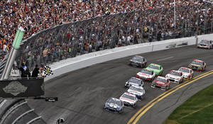 Photo - Jimmie Johnson (48) leads Dale Earnhardt Jr., (88) and Mark Martin (55) to the checkered flag to win the Daytona 500 NASCAR Sprint Cup Series auto race, Sunday, Feb. 24, 2013, at Daytona International Speedway in Daytona Beach, Fla. (AP Photo/David Graham)