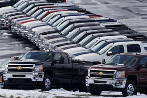 photo - Chevy trucks line the lot of a dealer in Murrysville, Pa.  AP Photo