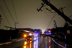 Photo - Power lines block Penn. Ave. just north of 150th in Oklahoma City after a storm moved through the area on Saturday, May 18, 2013. Photo by Bryan Terry, The Oklahoman <strong>BRYAN TERRY</strong>