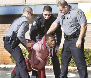 Photo - Oklahoma City police take a burglary suspect into custody near Oliver and Portland Avenue in Oklahoma City, Wednesday December 11, 2013. Photo By Steve Gooch, The Oklahoman