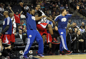 photo - Los Angeles Clippers forward Ronny Turiaf of France, from left, DeAndre Jordan and Blake Griffin react to a teammate's dunk in the second half of an NBA basketball game on Monday, Jan. 14, 2013, in Memphis, Tenn. The Clippers won 99-73. (AP Photo/Lance Murphey)